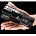 Фонарь Nitecore TM26 в руке пользователя