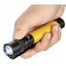 Желтый фонарь Olight S2A Baton в руке пользователя