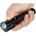 Черный фонарь Olight S2A Baton в руке пользователя