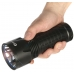 Поисковый фонарь Olight SR52 INTIMIDATOR в руке